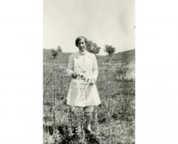 Ada Hayden standing in a pasture