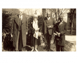 Louis Pammel and his wife Augusta standing with Robert R. Moton and George Washington Carver outside in front of a yucca plant